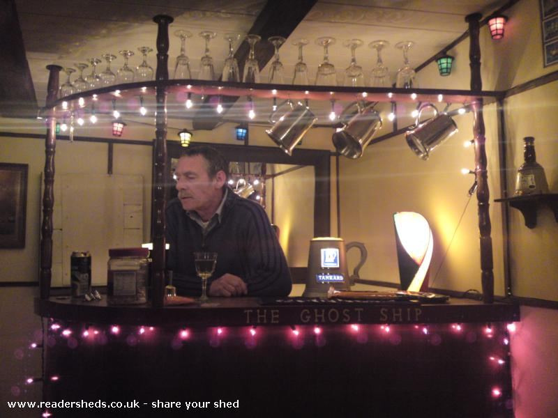 Photo of The Ghost Ship, entry to Shed of the year-Me behind the bar: no flash allows lighting to be shown at night.