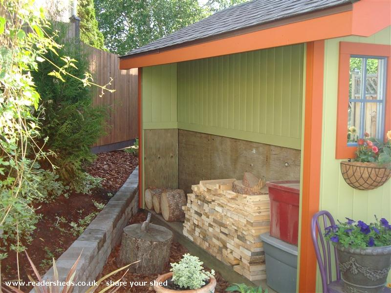Photo of Kathy's Shed, entry to Shed of the year-wood storage on side