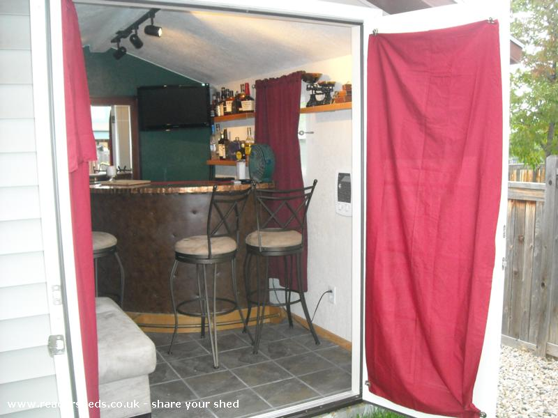Photo of Marilyn's, entry to Shed of the year-note the bourbon and flat screen TV