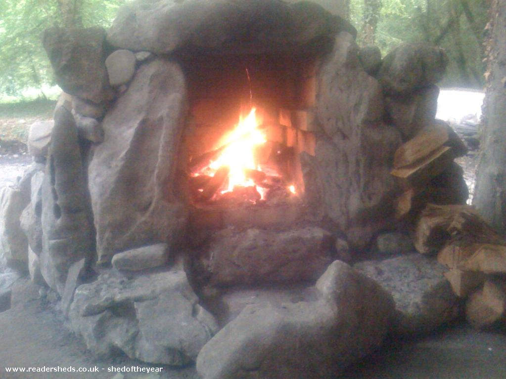 Photo of The Hooting Owl, entry to Shed of the year-The Fireplace blazing on the porch of The Hooting Owl