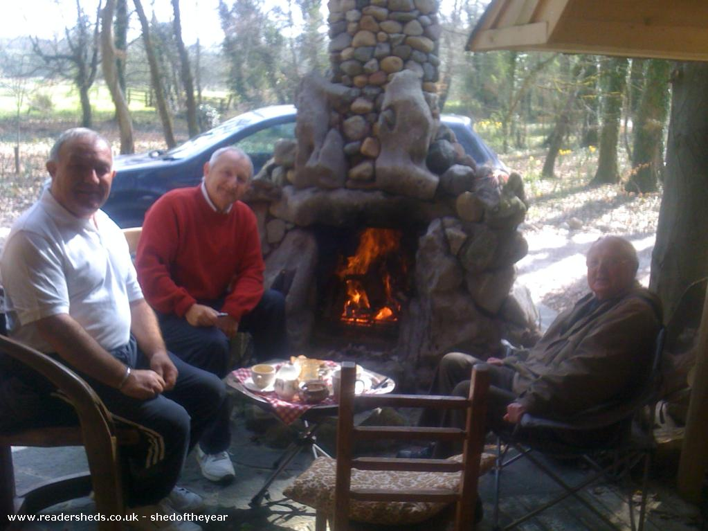 Photo of The Hooting Owl, entry to Shed of the year-Grandfather and pals enjoying the porch of The Hooting Owl