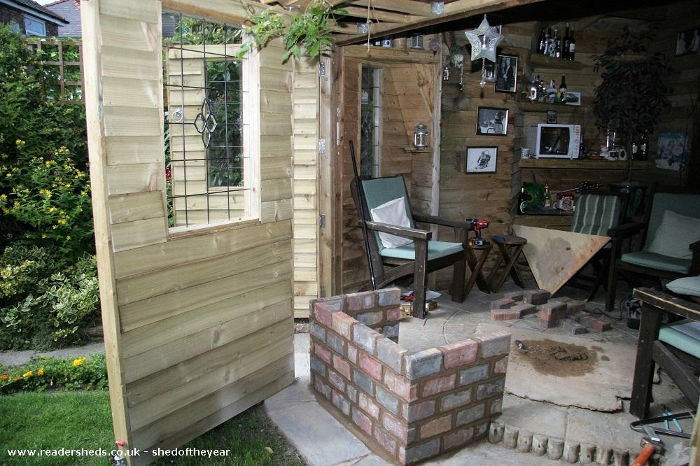 Photo of Love Shack Argentum, entry to Shed of the year-Construction of brick wood burner surround