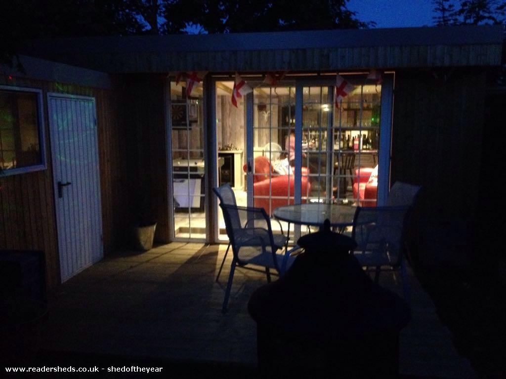 Photo of Bert and Ernies bar at the bottom of the garden, entry to Shed of the year-Evening view
