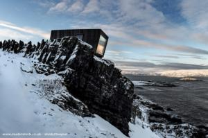 The Kongsfjord cliff shelter - Tormod Amundsen - On the edge of a cliff at the arctic ocean