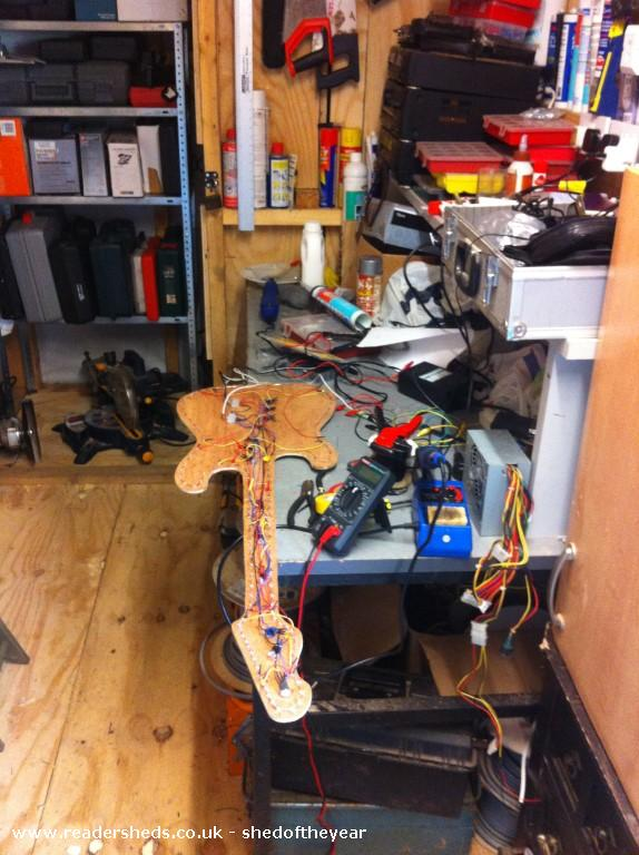 Photo of The Old Orchard, entry to Shed of the year-Light Guitar being made in workshop to the rear of Bar.