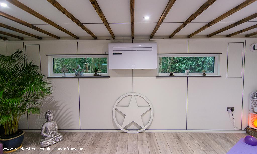 Photo of The Yoga Cabin, entry to Shed of the year-windows and heat source pump